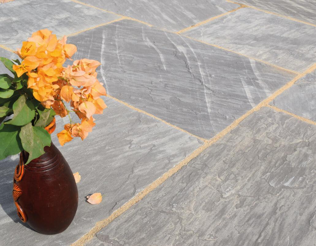 Grey paving with orange flowers