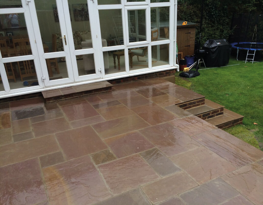 Brown garden paving outside conservatory